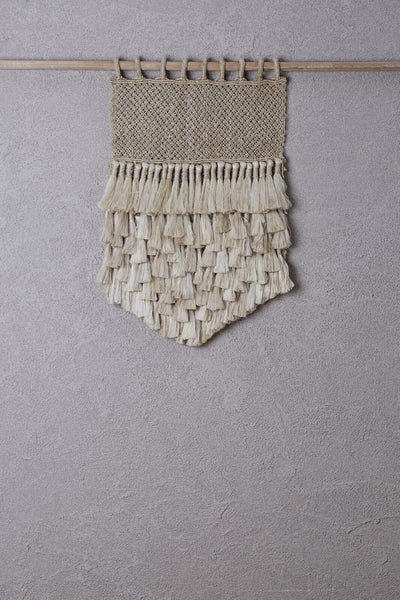 small jute wall hanging on bamboo hanging rod
