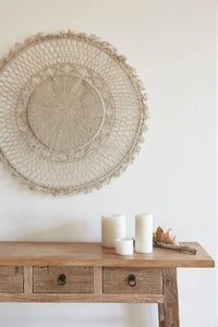 jute mandala wall hanging above table