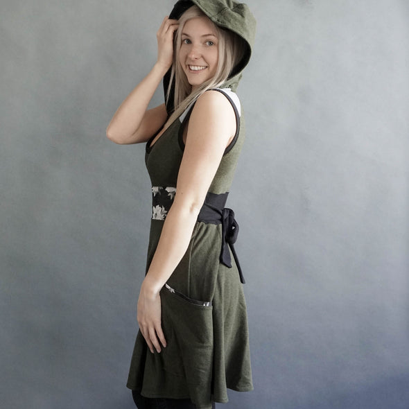 the model is showing the fun flowy circle skirt and patch pockets.