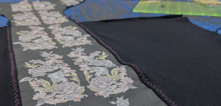 Us working on this design in our sewing studio
