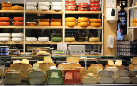 A colorful collection of different flavors of Gouda Cheese!