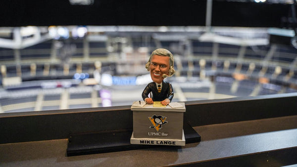 Mike Lange bobblehead in a broadcast station