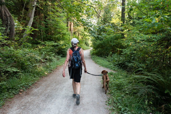 Lady hiking with a dog
