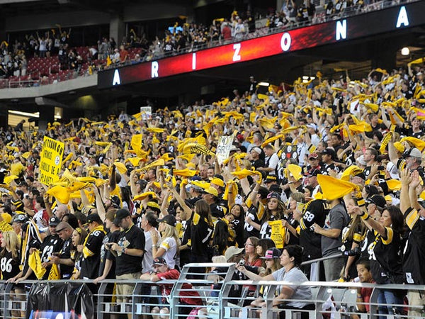 The crowd cheering for Pittsburgh Steelers, a cheery crowd for a game day at Pittsburgh