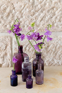 Selection of vintage purple bottles