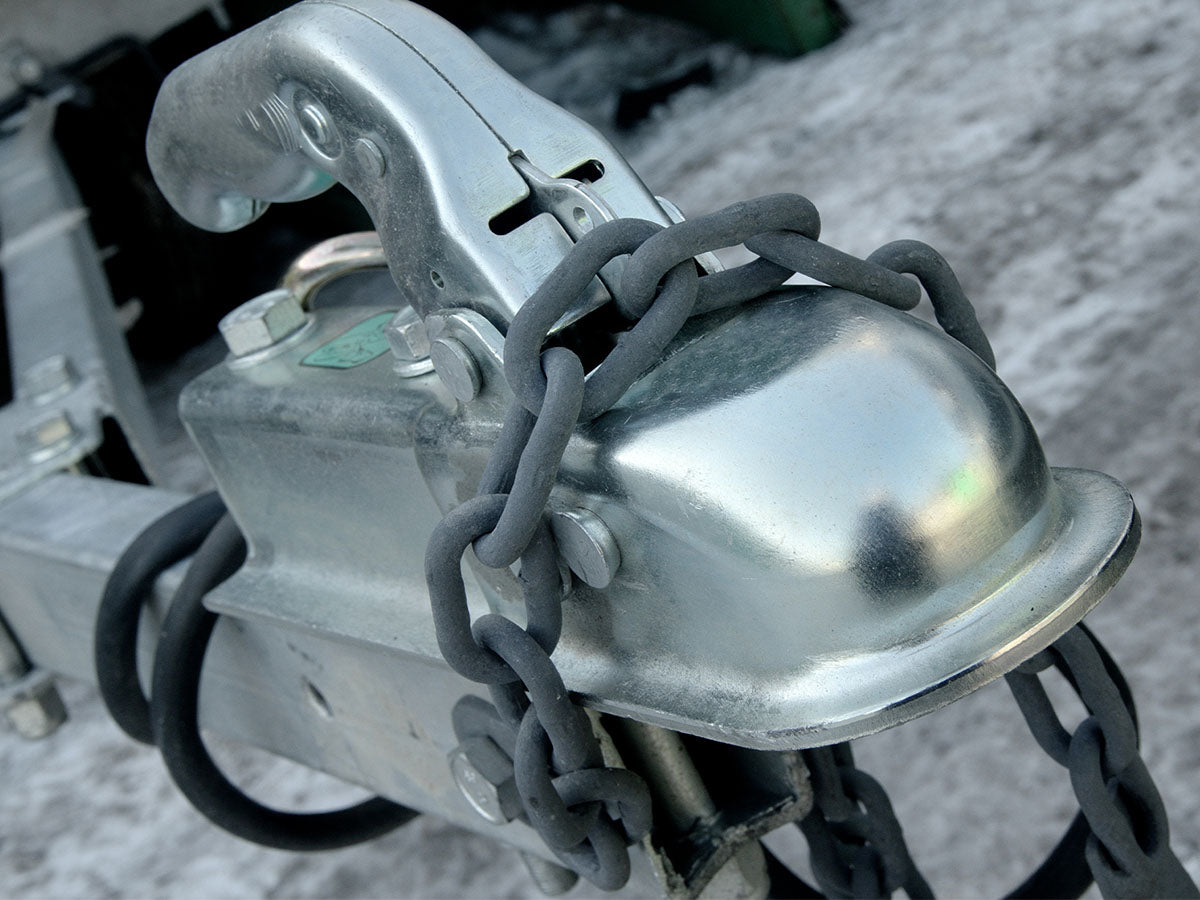 Image of a hitch attached to a trailer.