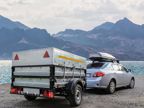 Image of a trailer attached to a car.