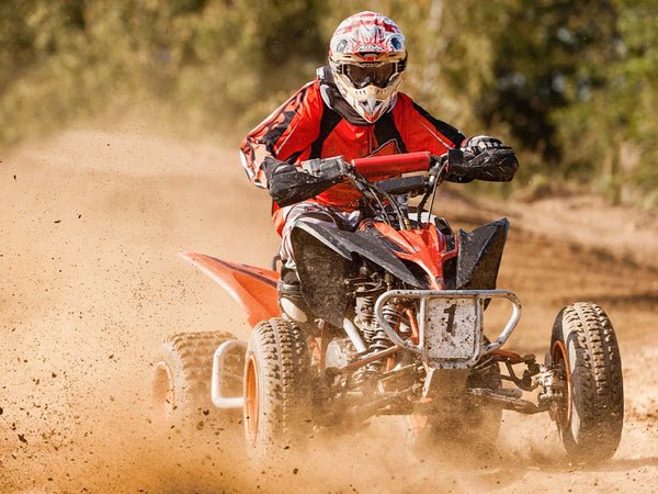 Image of a person off-roading in an ATV.