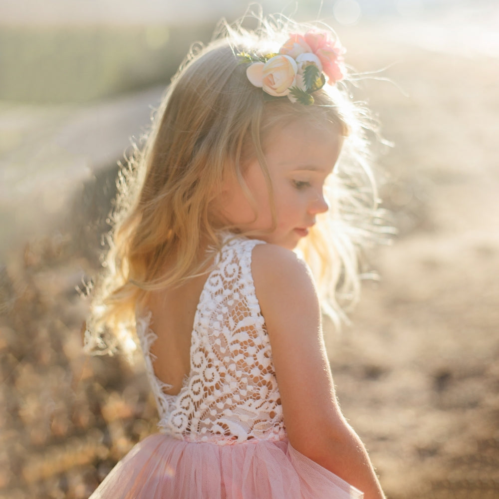 Girl wearing Boho Dreams Pink Flower Girl Dress with lace and tulle