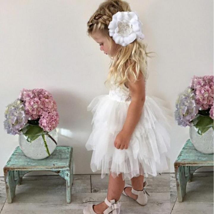 Young girl in a white Boho Dreams Flower Girl Dress