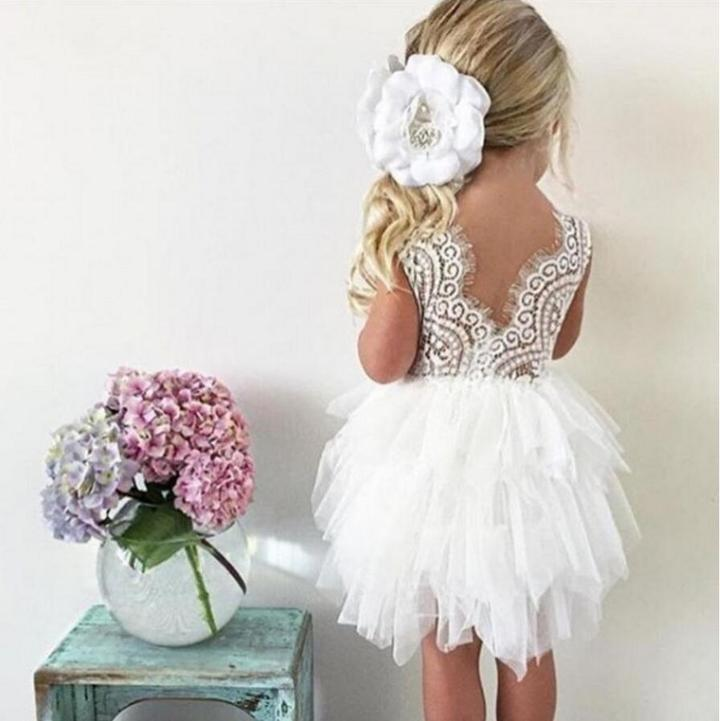 Young girl in a white Boho Dreams Flower Girl Dress  Edit alt text