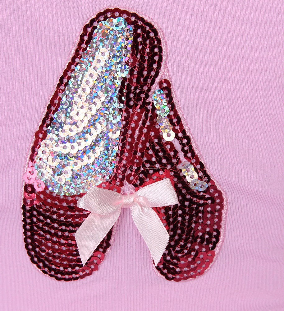 sequin slippers on a pink leotard