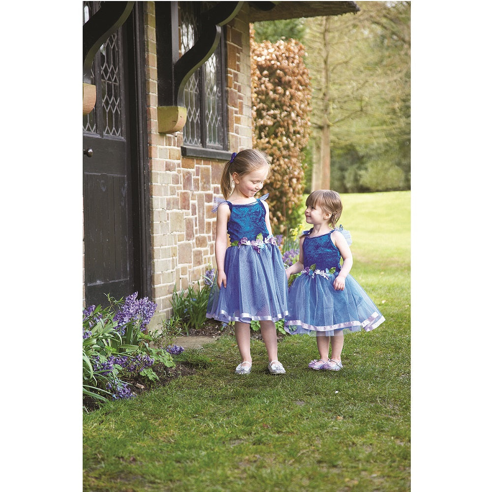Two girls in a garden wearing royal blue Flower Fairy costumes