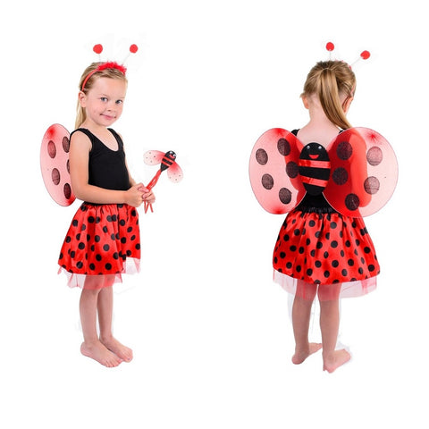 Girl wearing a red and black lady bug costume