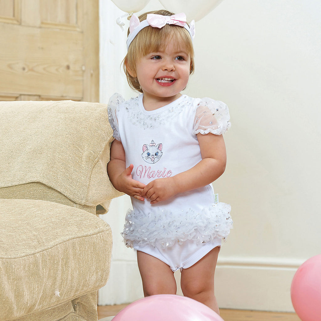 Little girl wearing a Baby Cat Tutu Romper