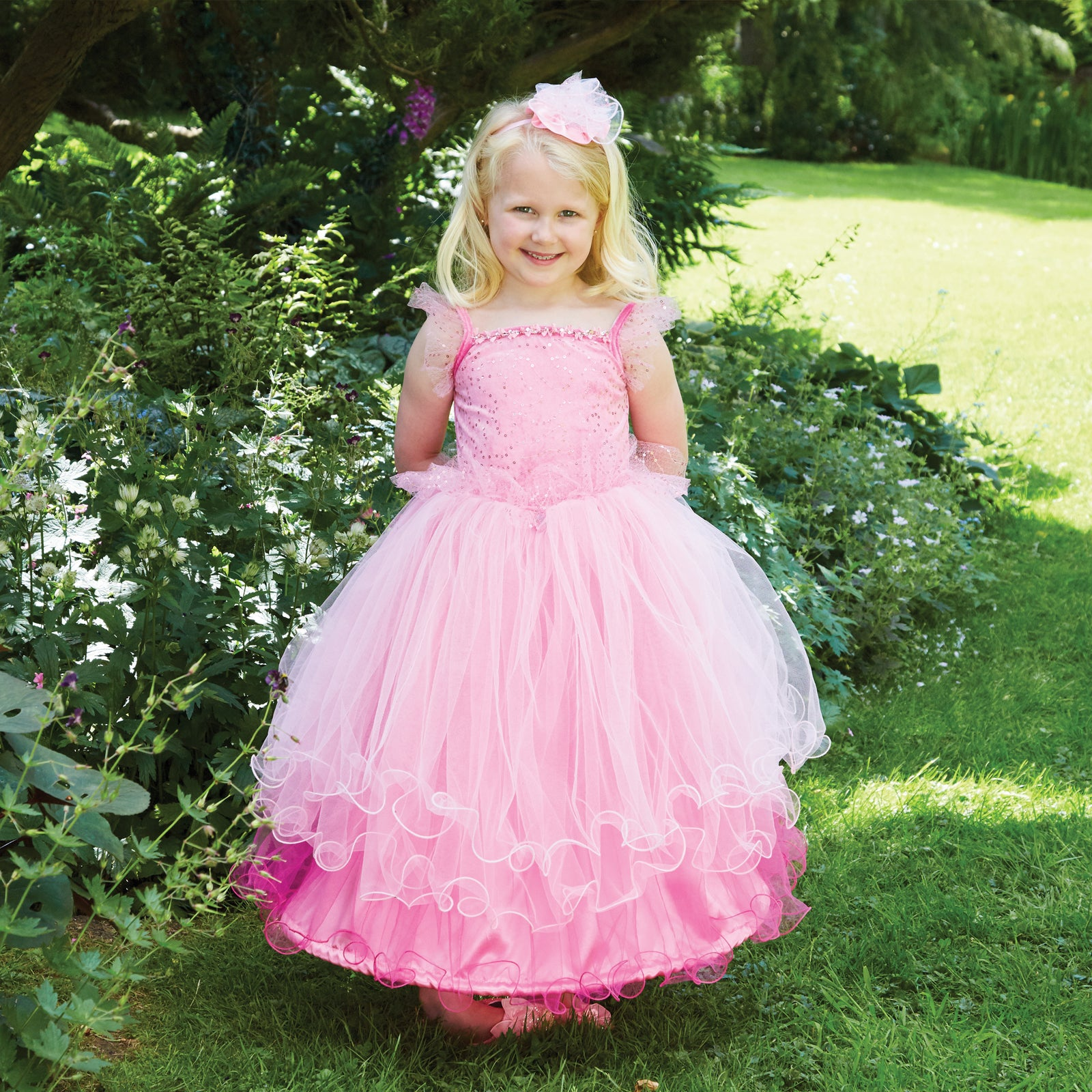 girl in a garden wearing a Pink Sweetheart Princess Dress