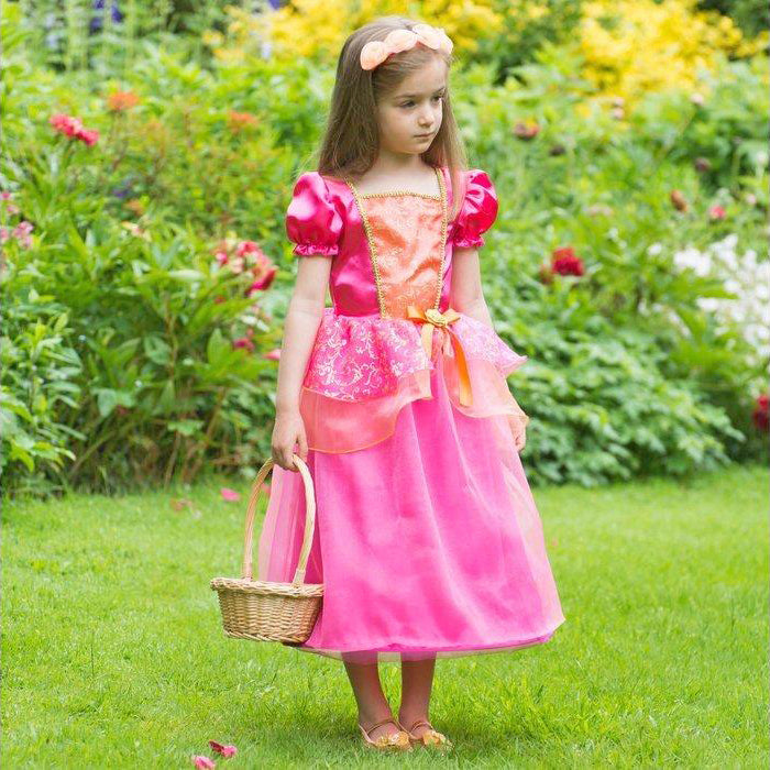 girl in a garden wearing a Vibrant orange and pink Princess costume with matching headband