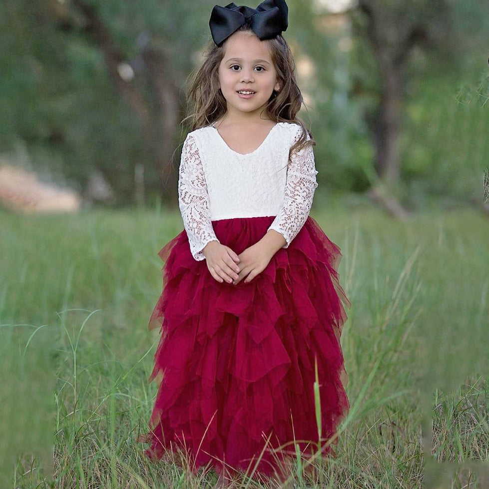 Girl in a park wearing a burgandy and white bohemian style party dress