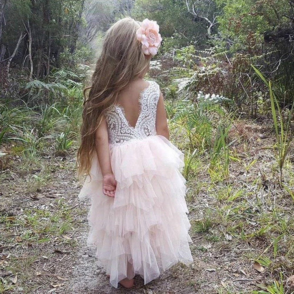 girl wearing a white flower girl lace and tulle dress