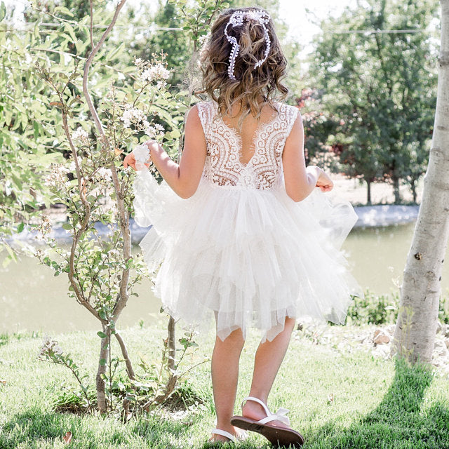Gril wearing a Boho Dreams White Flower Girl Dress
