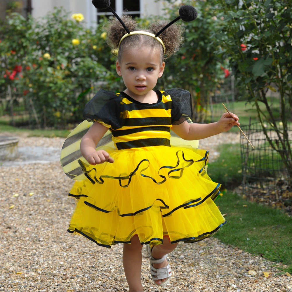 Girl wearing  a yellow three piece bumble bee costume