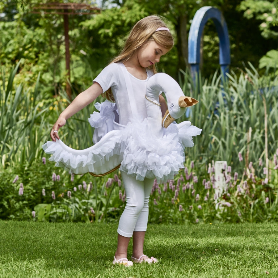 girl wearing swan costume in a garden