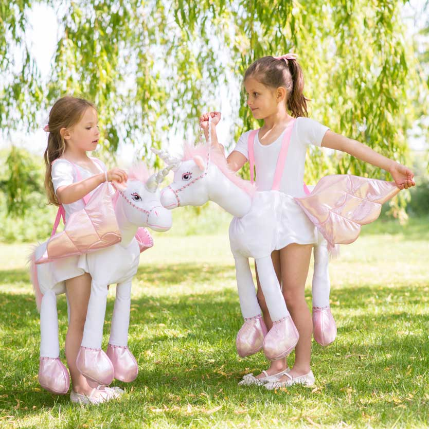 Girls playing in Ride On Unicorn Outfits