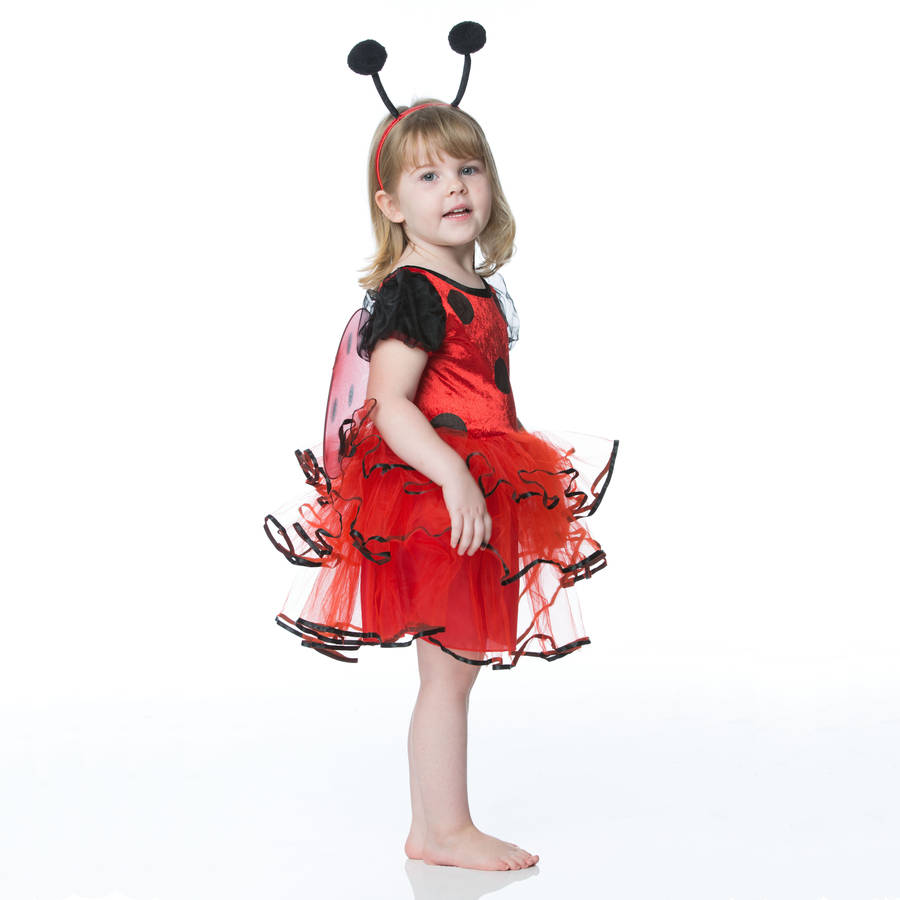 Girl wearing a red and black Ladybug costume  Edit alt text