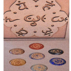 ENGRAVED CHAKRA SET WITH SANSKRIT SYMBOL BOX.