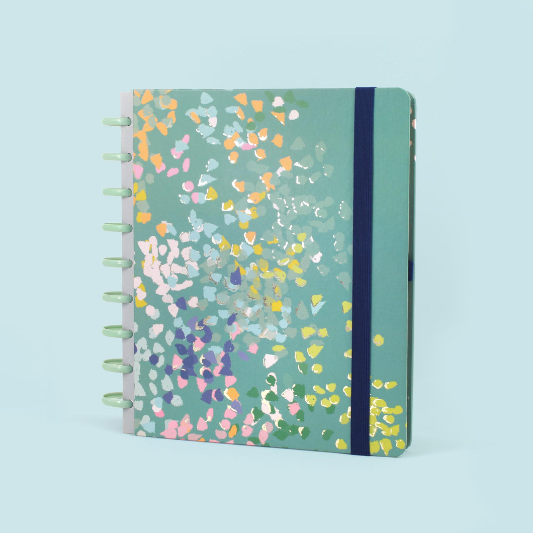 The Busy Days planner on a light blue background.