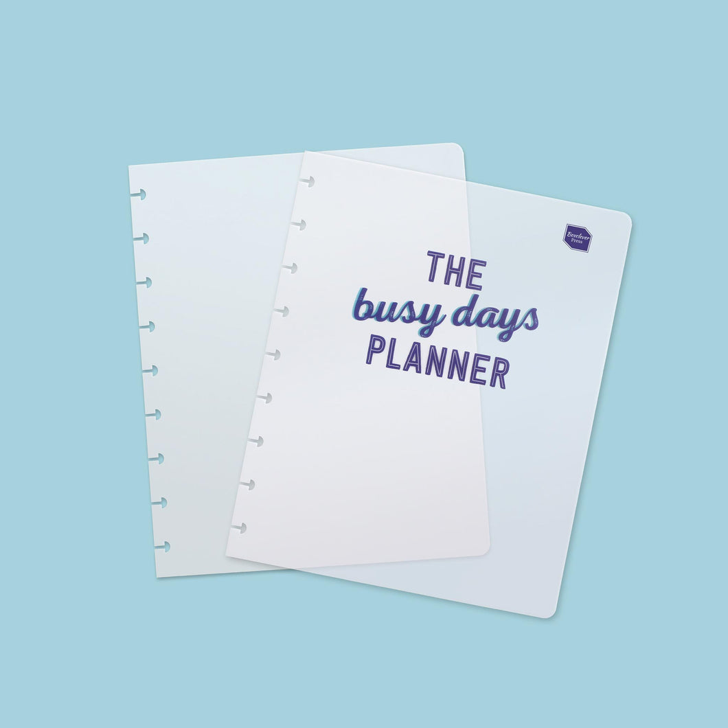 BD_COVERS-1-Category_1 Two Busy Days Planner clear plastic covers which have wording 'The Busy Days Planner' written in script font