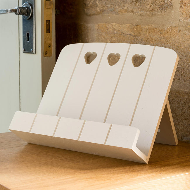 DS-1-CREAM_2 Cream wooden diary stand with heart decoration stood on sideboard next to stone wall