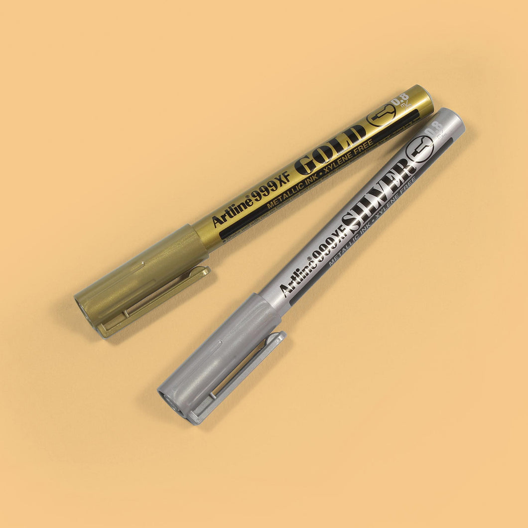 METPEN-Category Gold and silvery metallic pens from Artline on orange background
