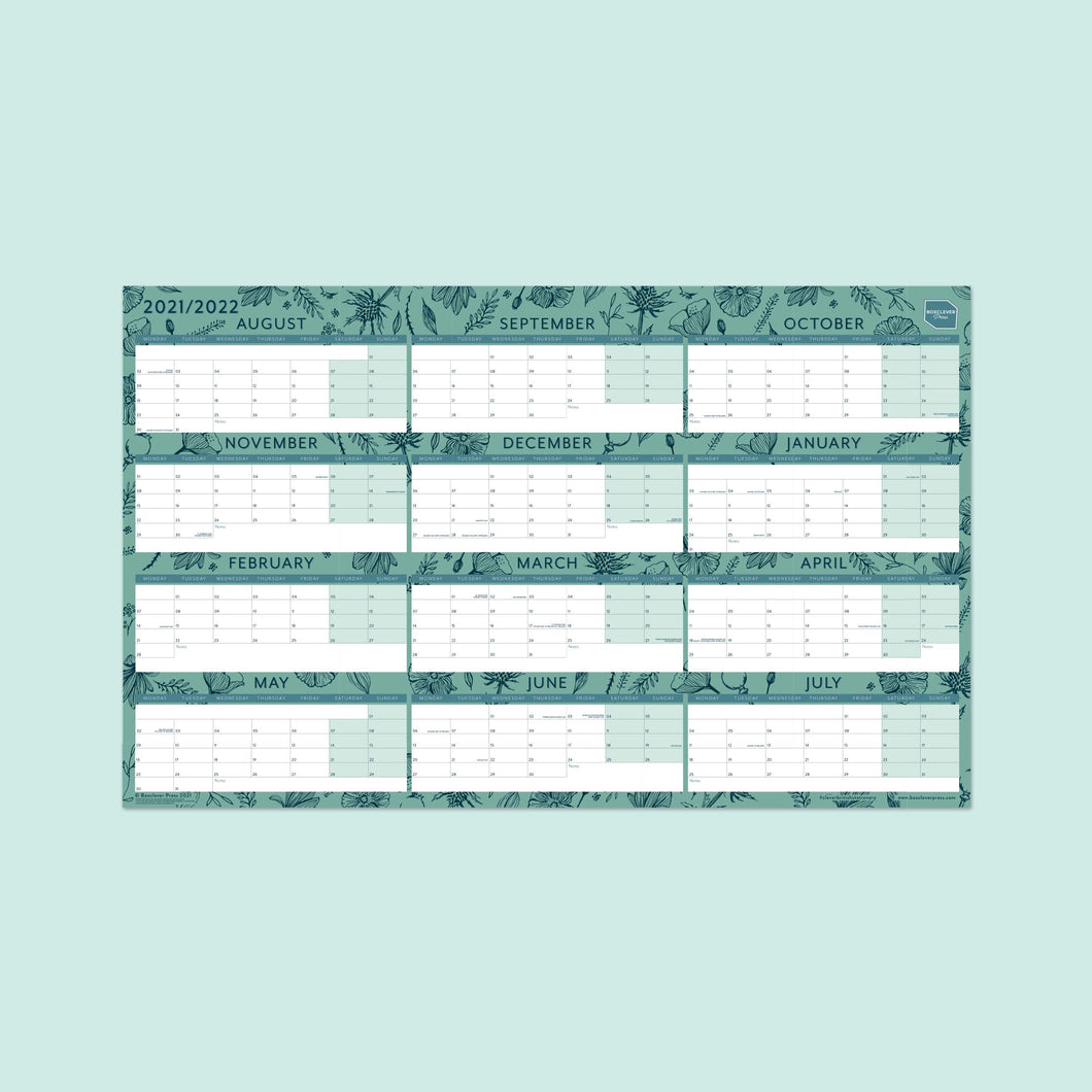 The wall planner's blue floral design against a pale blue background.