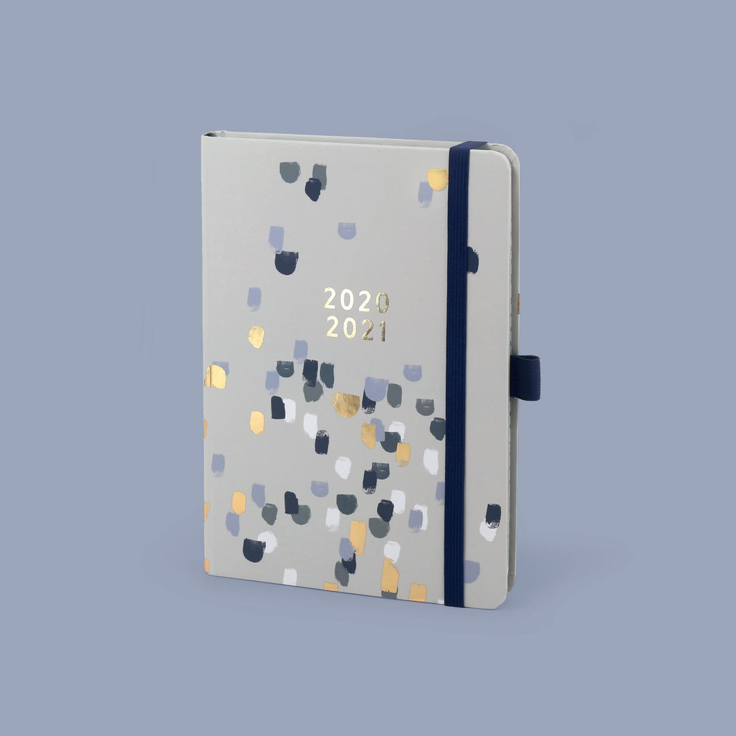 The perfect year academic a5 diary on a grey background