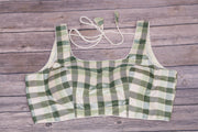 Off white and olive green check slevelss blouse