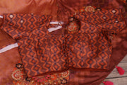 Brown semi georgette saree with stitched blouse