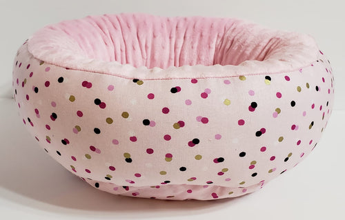 Small round bed pink dots