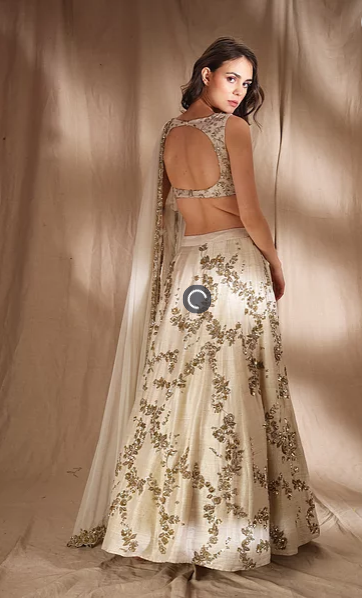 Astha Narang Ivory and Gold Lehenga - The Grand Trunk