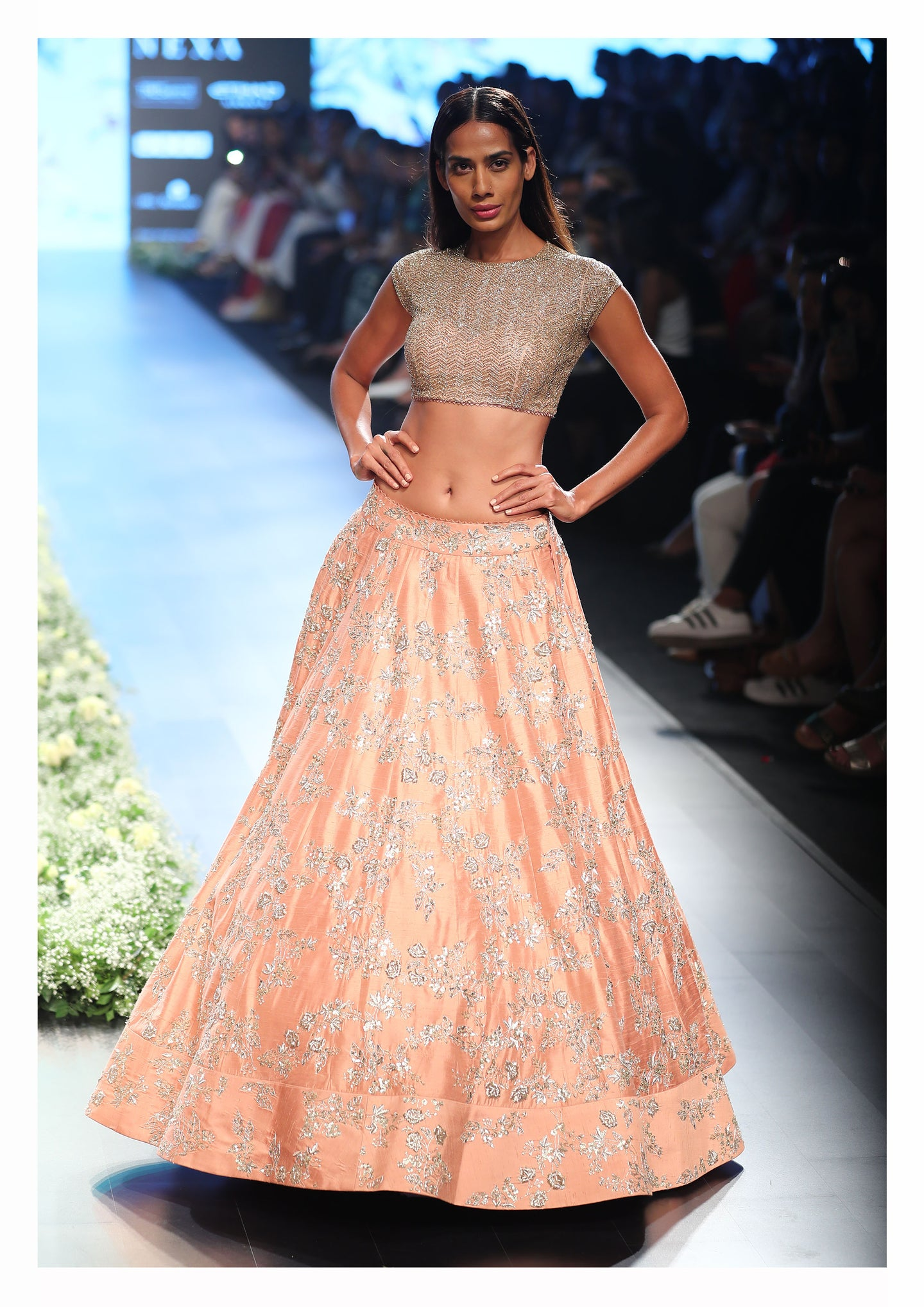Peach Rawsilk Embellishedlehenga and Shimmer Blouse.