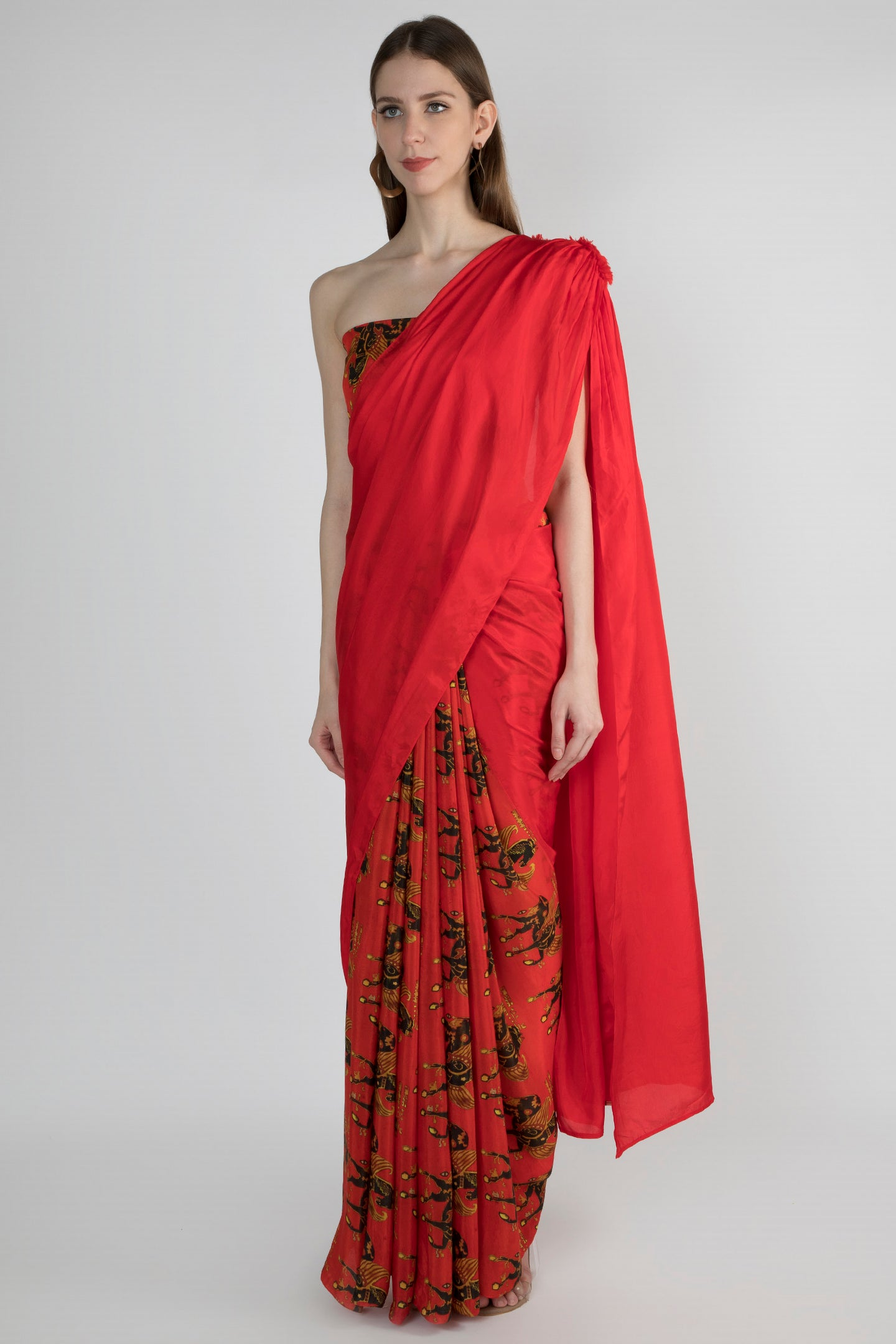 RED PATCHWORK PANEL GATHERED SARI WITH FRAY DETAIL AND RED LEGEND PRINT PLEATS WITH BLOUSE PIECE - The Grand Trunk
