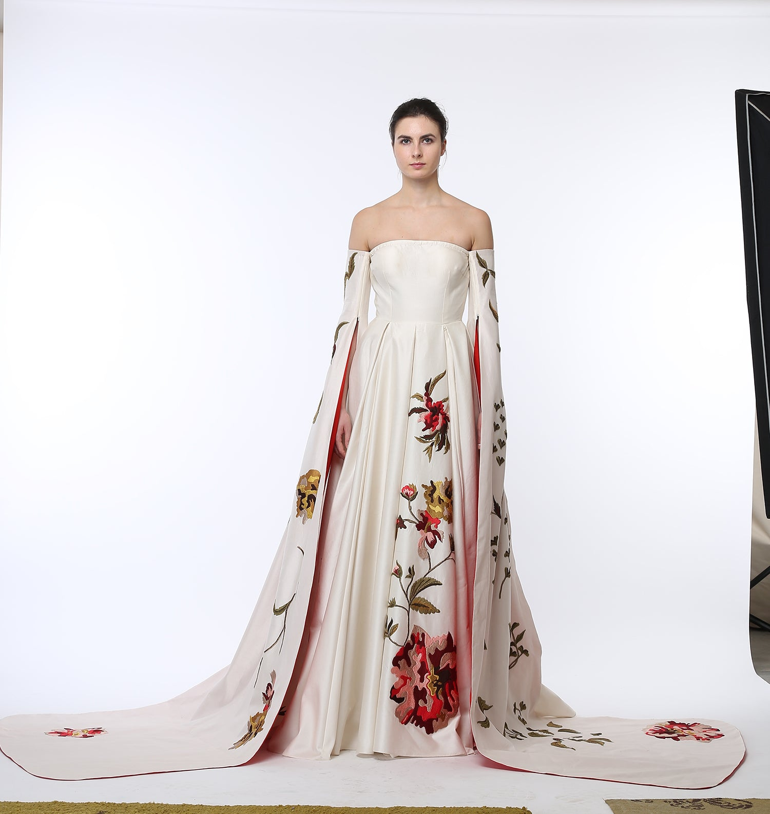 Off-Shoulder Buster Embroidered Gown.