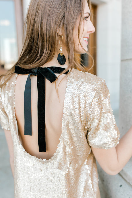 gold sequin party dress with black bow