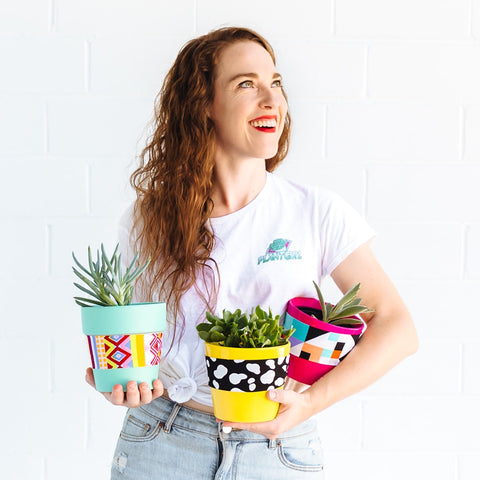 Happy woman holding plants - PlantGirl Sydney