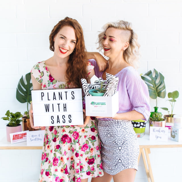 Happy women holding plants - PlantGirl Sydney