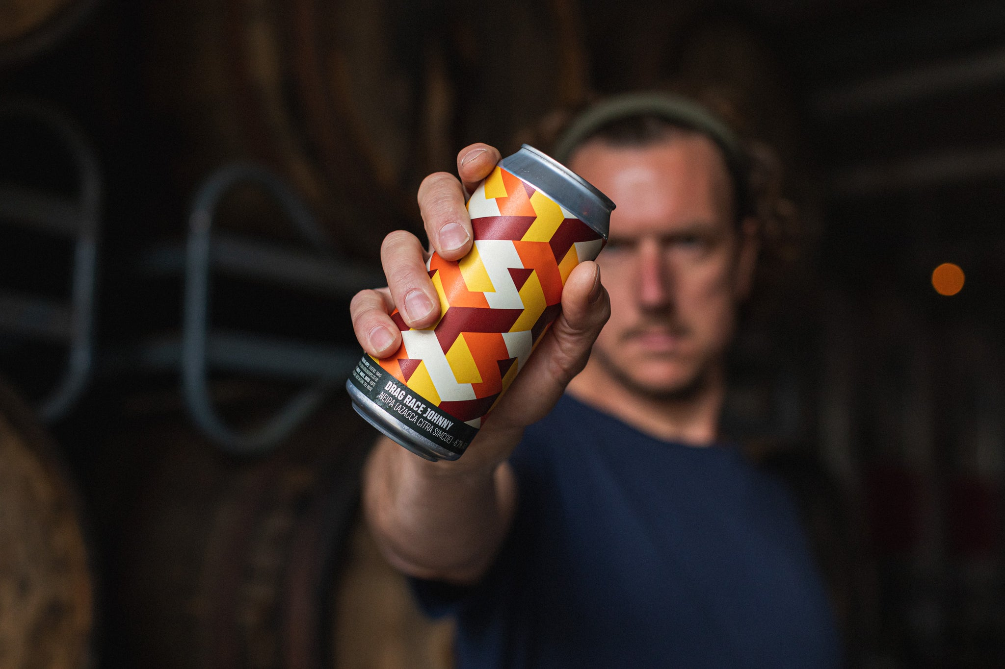 Peter Holt holding Howling Hops craft beer can
