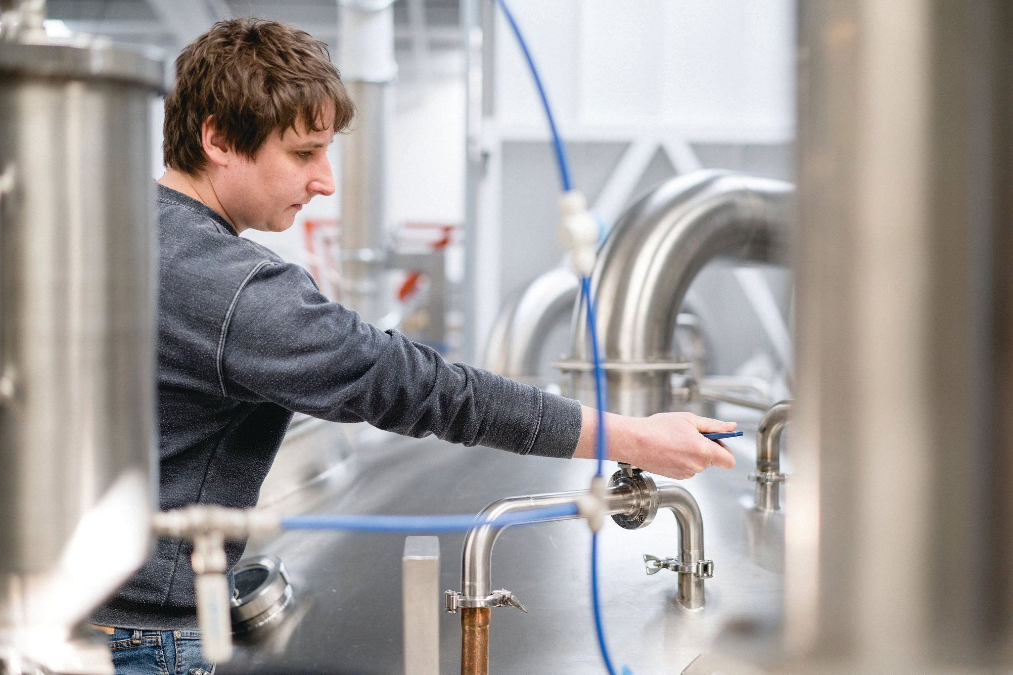 Oliver Fozard brewing beer at Rooster's brewery.