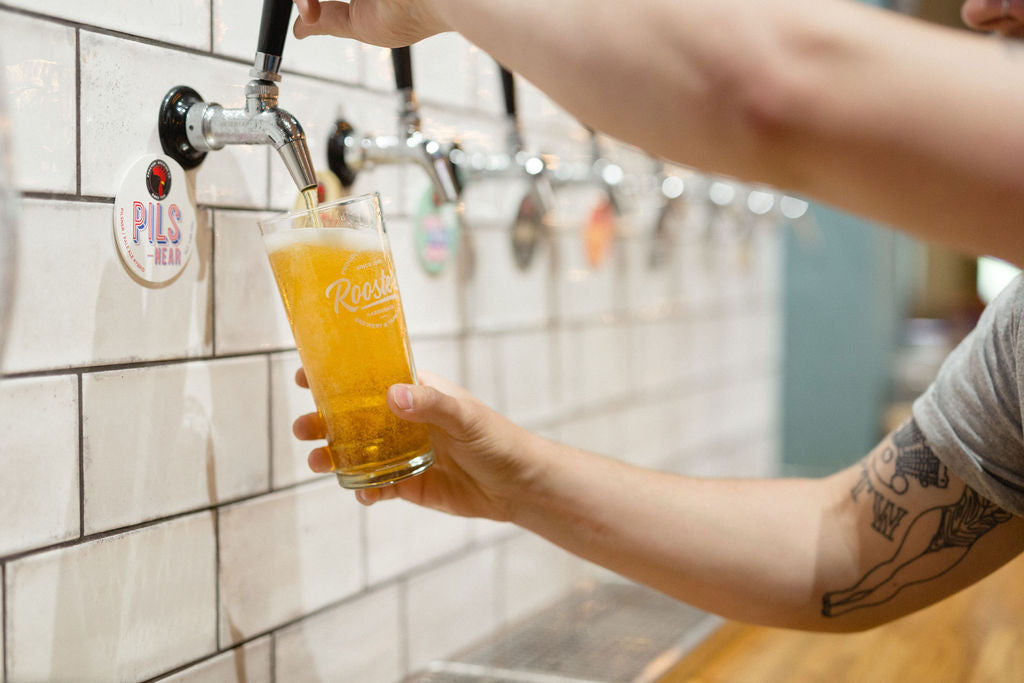 Pouring Rooster's Brewing Pils in the Harrogate craft beer tap room.