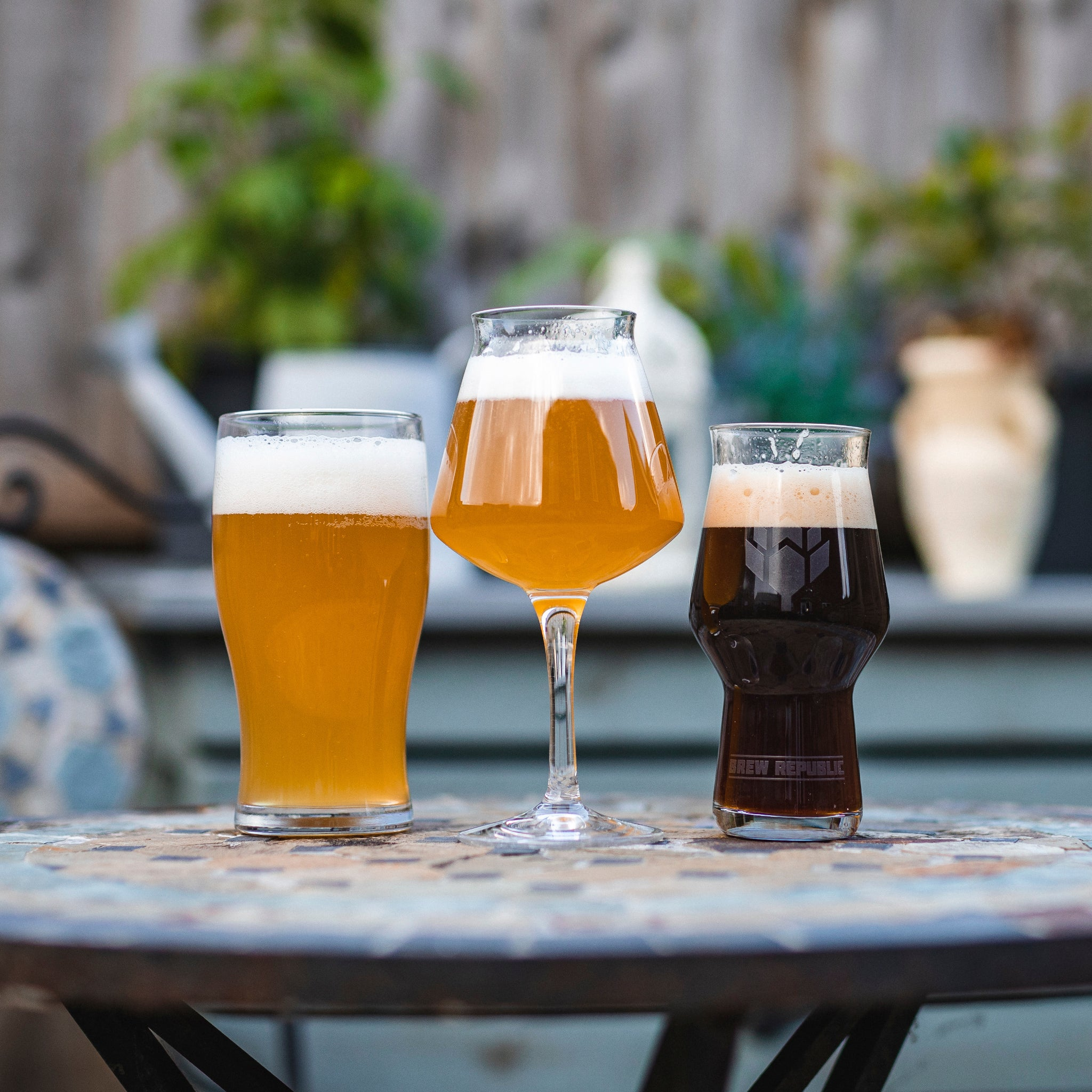 craft beer in glasses on table