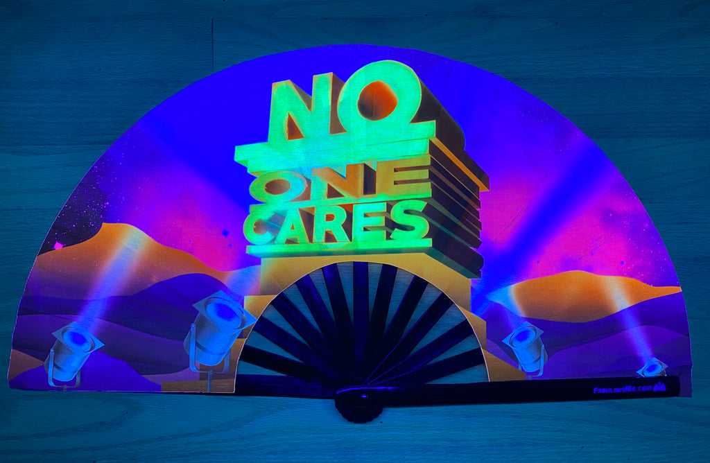 no one cares circuit party uv glow bamboo hand fan by fabulous me